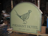 Hand painted double sided projecting sign
